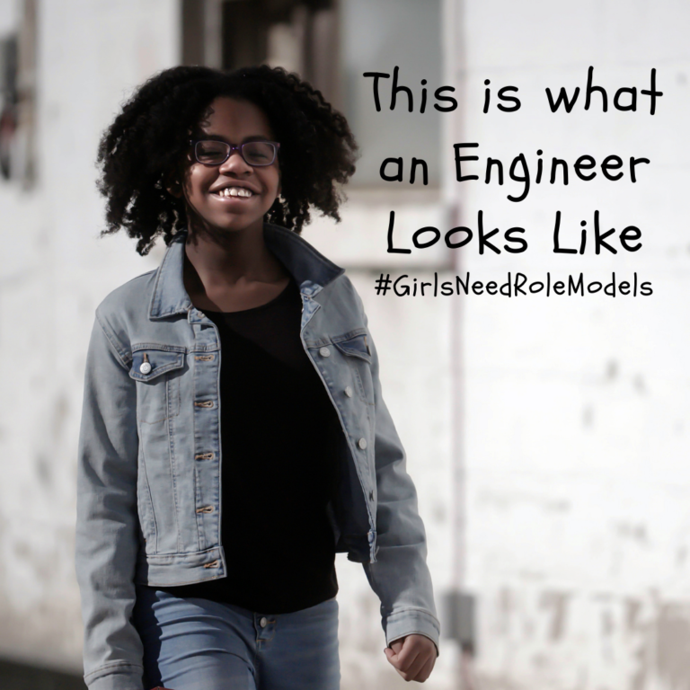 A smiling girl wearing glasses, jeans, a black t-shirt and a jean jacket with the caption THis is What an Engineer Looks LIke